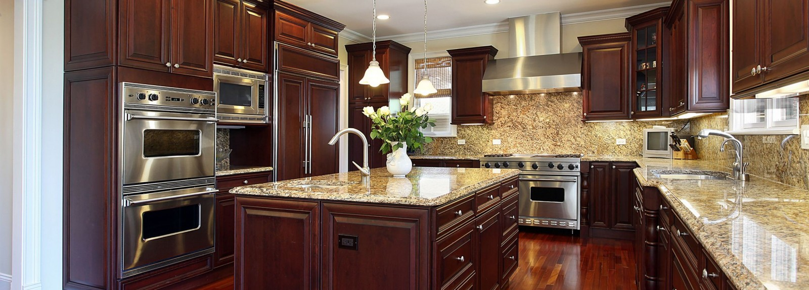 Kitchen with the darker cherry color cabinets